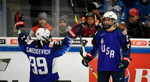 Melissa Sasmos Kevich, left, and Annie Pankowski of the USA celebrate a goal during the 2019 IIHF Women's World Championships