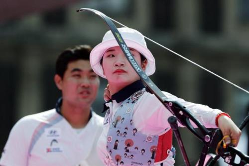 South Korea's Kang Chae Young and Im Dong Hyun go for mixed recurve gold at Mexico City's Archery Outdoor World Championships