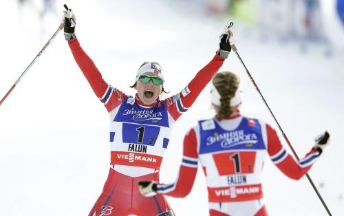 Norway's Maiken Caspersen Falla and  Ingvild Flugstad Oestberg celebrate after crossing the finish line during the Women's Cross