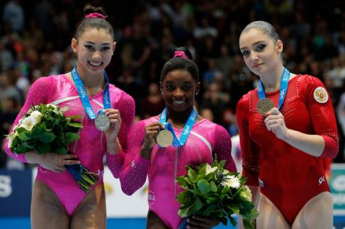 The USA's Biles (gold) and Ross (silver) at the Art. Gymnastics Worlds 2013
