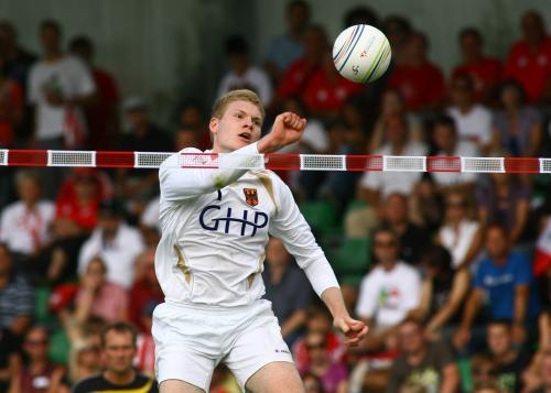 A leaping Fistball player for the German national team